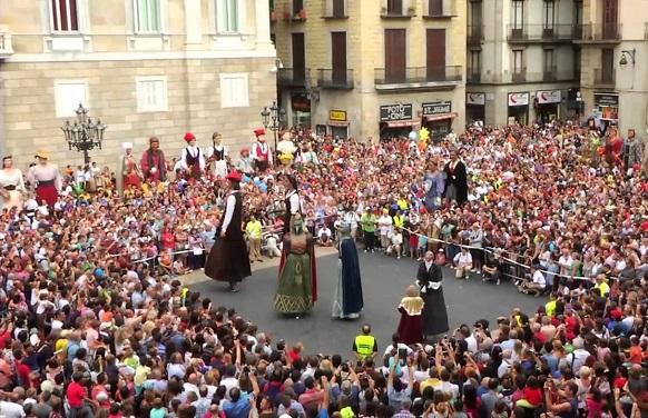 "A ""gigantes y cabezudos"" exhibition on Plaza Sant Jaume, one of the epicenter of La Mercé"