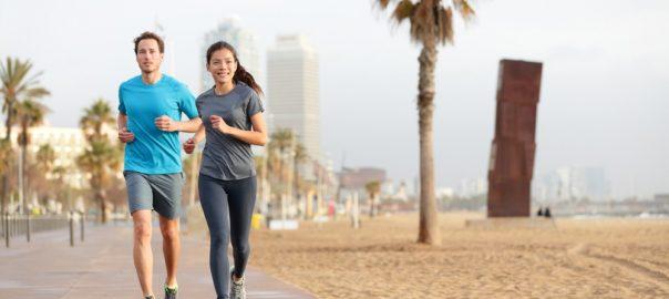 Running in Barcelona: running couple jogging Barcelona Beach Barceloneta